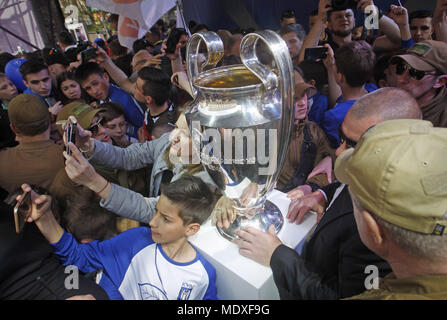 Kiev, Ukraine. 21st Apr, 2018. Ukrainians take photos of the UEFA Champions League trophy during a handover ceremony in downtown Kiev, Ukraine, on 21 April 2018. Kiev will host the UEFA Champions League Final matches on 24 and 26 May 2018. Credit: Serg Glovny/ZUMA Wire/Alamy Live News - Stock Photo