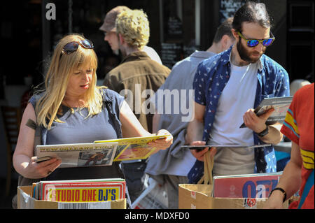London, UK.  21 April 2018.  Music lovers browse at an analogue music stall in Soho on the 11th Record Store Day.  Over 200 independent record shops across the UK come together annually to celebrate the unique culture of analogue music with special vinyl releases made exclusively for the day. Credit: Stephen Chung / Alamy Live News - Stock Photo
