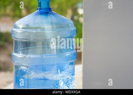 Water Gallon Refill Vending Station filling with water in a special place with space for text - Stock Photo