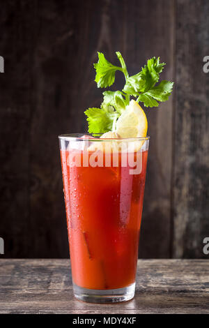 Bloody Mary cocktail in glass on wooden table. - Stock Photo