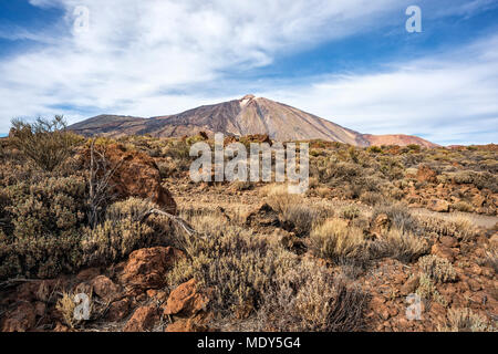 Canadas del Teide, Tenerife, Spain - December 9, 2017: Pico del Teide and pico Viejo seen from lava field on the East. - Stock Photo
