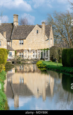 Cotswold stone house along the river windrush in Bourton on the Water, Cotswolds, Gloucestershire, England - Stock Photo