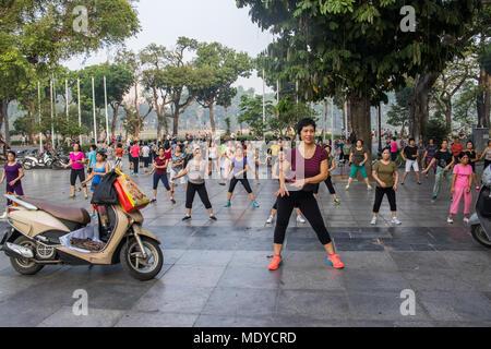 People exercising in the early morning; Hoan Kiem, Hanoi, Vietnam - Stock Photo