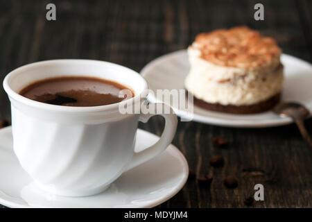 a cup of coffee and tiramisu - Stock Photo