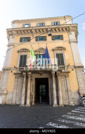 A building in Rome, Italy on a sunny winter morning flying both the Italian and European Union flags. - Stock Photo
