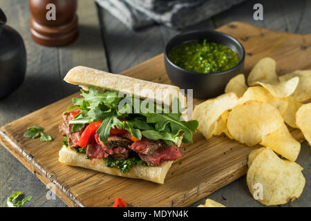 Homemade Beef Steak Sandwich with Chimichurri and Arugula - Stock Photo