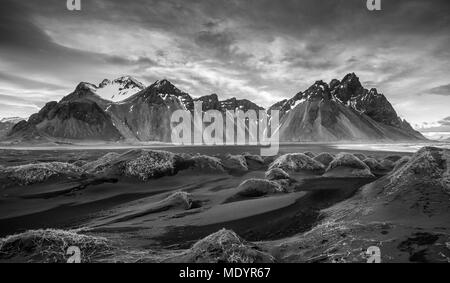 Black and white image of Icelandic Landscape Southern Iceland, Hofn, Stokksnes peninsula with the famous Vestrahorn Mountains and dramatic sky. - Stock Photo