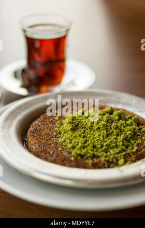 Turkish Dessert Kunefe with Pistachio Powder. Traditional Food. - Stock Photo