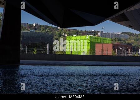 France, Lyon, view over the Cube Vert (architect Jakob + Macfarlane) from the Musée des Confluences, architect : Agence Coop Himmelb(l)au, - Stock Photo