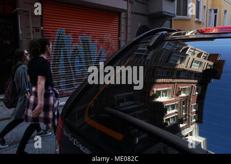 Istanbul, Turkey - April 19, 2018 : Perfect reflections of the Turkish Houses on a vehicle window and also modern young Turkish People are walking at - Stock Photo