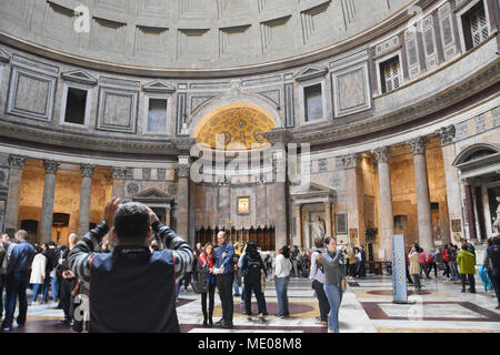 Tourists taking photos inside the Pantheon. The Pantheon is a former Roman temple, now a church, in Rome. The present building was completed by the em - Stock Photo