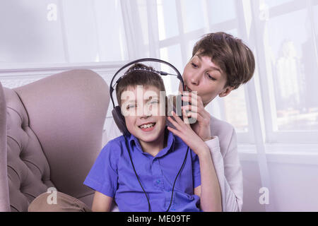 Mother screaming to her son while he listening music and doesn't listen - Stock Photo