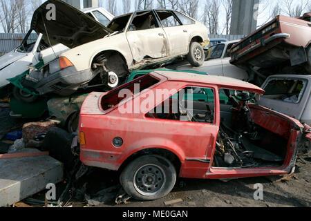 Crushed cars in junkyard - Stock Photo