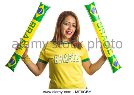 Brazil supporter. Brazilian woman fan celebrating on soccer / footbal match isolated on white background. Brazil colors. Woman wearing generic brandle - Stock Photo