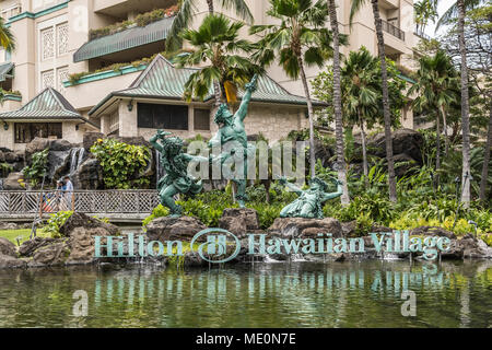 Hula Kahiko dancer statues at Hilton Hawaiian Village, Waikiki; Honolulu, Oahu, Hawaii, United States of America - Stock Photo
