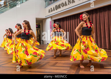 Hula dancers entertaining shoppers at the Ala Mona Shopping Center's stage in Waikiki; Honolulu, Oahu, Hawaii, United States of America - Stock Photo
