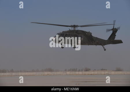 The Task Force Marauder medical evacuation (medevac) company participated in a mass casualty exercise with the Role 3 hospital, Dec. 23, 2017, in Afghanistan to practice and refine procedures in the event of a real-world emergency.  Detachment 1, Charlie Company, 2-211th General Support Aviation Battalion (GSAB), MEDEVAC, Iowa National Guard, with Task Force Marauder partnered with the hospital, base emergency medical services, Polish special forces, U.S. Air Force security forces, and U.S. Army 82nd Airborne service members for the exercise.  C Co., 2-211th GSAB (MEDEVAC) provided aerial tran - Stock Photo