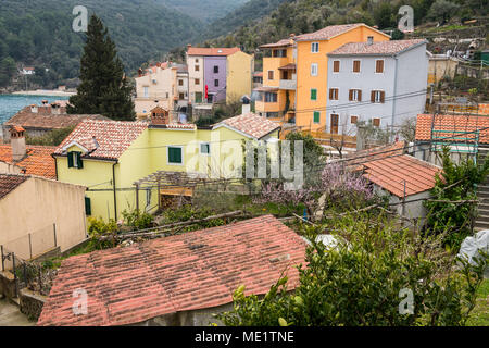 The small village Valun on the Island Cres (Croatia) on a cloudy day in spring - Stock Photo
