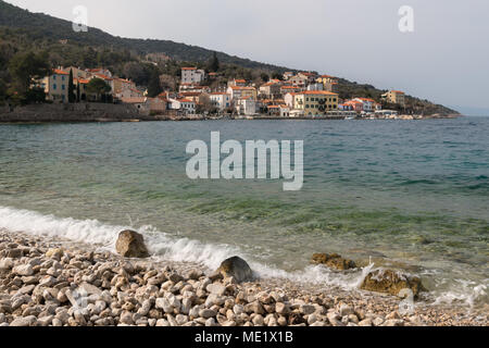 The beach of Valun (Island Cres, Croatia) on a cloudy day in spring - Stock Photo
