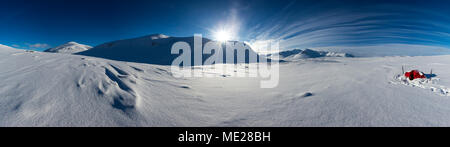 Tent with sun in the snow, Kungsleden or king's trail, Province of Lapland, Sweden, Scandinavia - Stock Photo