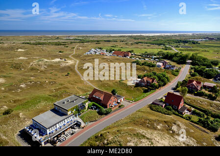 View from the Norderney Lighthouse to the island landscape with restaurant and camping sites, Norderney, East Frisian Islands - Stock Photo