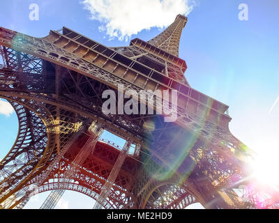 Eiffel Tower from the bottom up in the sunset, Paris, France - Stock Photo