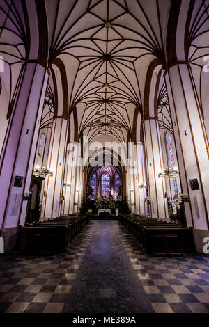 Interior of the Jesuits church in Warsaw Poland, completely empty and with purple lights - Stock Photo