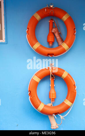 Two Lifebuoys and floating lanterns positioned on a boat - Stock Photo