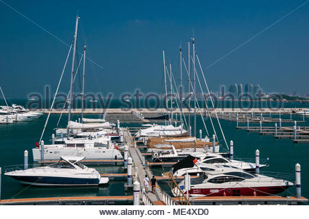 Boats moored at the Serenity Marina in Sanya on China's Hainan Island. - Stock Photo