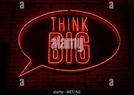 Think big neon sign in Yate's bar in Manchester - Stock Photo