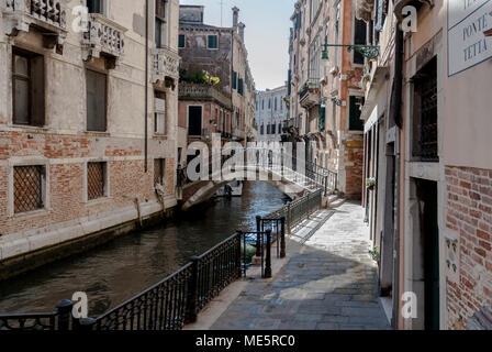 VENICE-MARCH 10 : view of a typical Venice street (calle),with the canal and a bridge,Venice,Italy,on March 10,2017. - Stock Photo