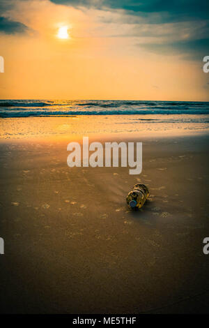 Plastic bottle on sea shore - Stock Photo
