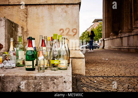 Empty alcohol bottles left in the street - Inner city outdoor drinking problem in Munich Germany. - Stock Photo