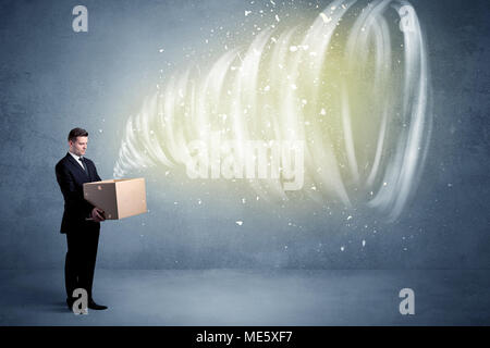 An illustrated powerful whirlwind escaping, coming out of empty paper box held by elegant businessman concept. - Stock Photo
