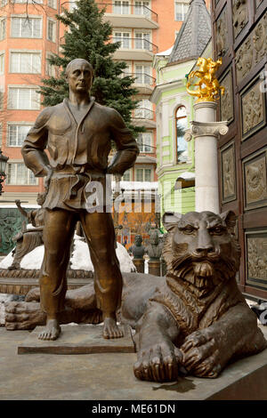 Moscow, Russia - March 22, 2018. Statue of Vladimir Putin in judo costume, with tiger at his feet, in the courtyard of Tsereteli museum in Moscow. - Stock Photo