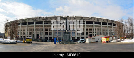 Moscow, Russia - March 22, 2018. Exterior view of Luzhniki stadium in Moscow, with Lenin monument, vehicles and people. - Stock Photo