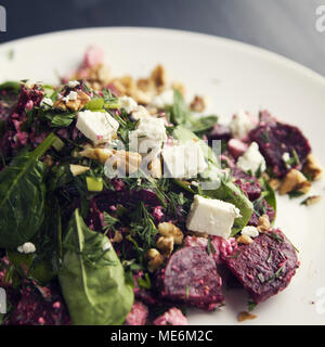 Beetroot salad with cottage cheese, baby spinach and walnuts. European cuisine. Organic food. Vegetarian appetizer. Healthy lifestyle. Simple side dis - Stock Photo