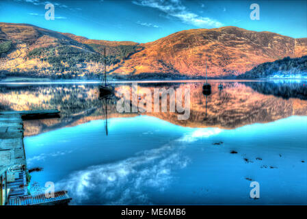 Area of Gen Coe, Scotland. Artistic dusk view of leisure craft anchored in Loch Leven near the Glencoe Boat Club. - Stock Photo
