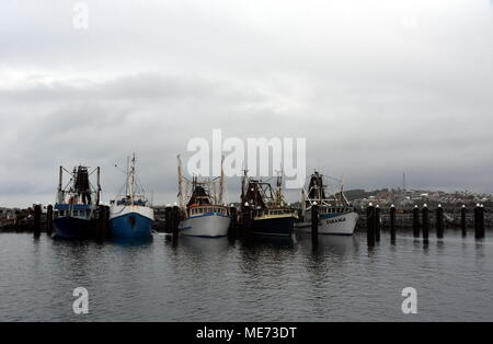 Coffs Harbour, Australia - Dec 31, 2017. Fisher boats at the marina in Solitary Islands Marine Park on a cloudy day. - Stock Photo