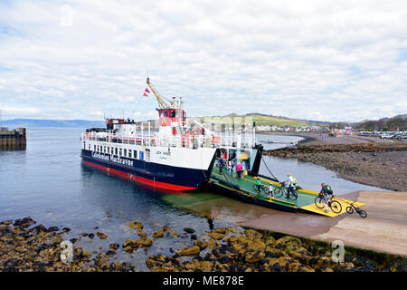 Scotland, UK. 21st April, 2018. Families boarding the Calmac ferry, Loch Ranza, at Largs, Ayrshire which sails to the Isle of Cumbrae where people enjoy cycling and walking the 10.25 miles around the island. Credit: PictureScotland/Alamy Live News  - Stock Photo
