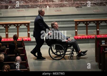 Former president George W. Bush pushes wheelchair of his father, former president George H.W. Bush, into the funeral service for former First Lady Barbara Bush at St. Martin's Episcopal Church in Houston. - Stock Photo