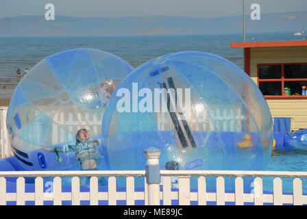 Weymouth, Dorset. 21st April 2018. Children have fun in sunny Weymouth, enjoying an early taste of summer weather Credit: stuart fretwell/Alamy Live News - Stock Photo