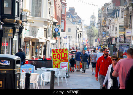 Weymouth, Dorset. 21st April 2018. People enjoy the shade of Weymouth's shopping streets on another hot and sunny day for the busy Dorset resort Credit: stuart fretwell/Alamy Live News - Stock Photo