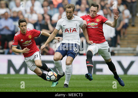 London, UK. 21st Apr, 2018. Tottenham Hotspur's Harry Kane (C) vies with Manchester United's Ander Herrera (L) and Phil Jones during the FA Cup semi-final between Manchester United and Tottenham Hotspur at Wembley Stadium in London, Britain on April 21, 2018. Manchester United won 2-1 and advanced to the final. Credit: Tim Ireland/Xinhua/Alamy Live News - Stock Photo