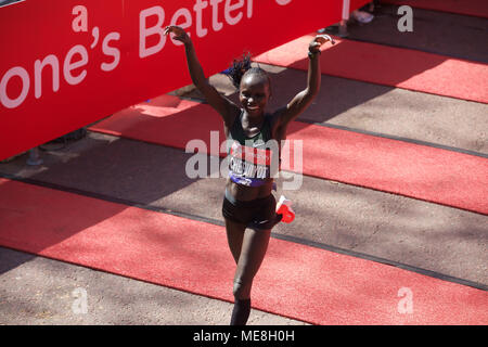 London,UK,22nd April 2018,Vivian Cheruiyot wins the London Marathon. The weather forecast makes it one of the hottest days too so runners have been advised not to wear costumes and stay hydrated to hopefully make it to the Finish Line in The Mall.Credit Keith Larby/Alamy Live News - Stock Photo