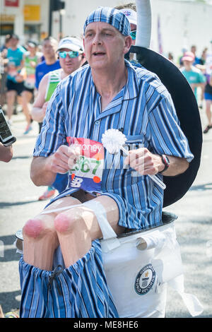 London, UK. 22nd April, 2018. Robert Prothero runs to raise money for Water Aid dressed as a toilet at the 38th London Marathon as it passes through Evelyn Street in south east London. Credit: Guy Corbishley/Alamy Live News - Stock Photo
