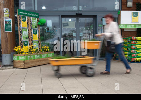 Southport, Merseyside, UK 22 April 2018. . UK Weather. Gardeners flock to Garden Centres as the warm weather continues, tempered with light showers earlier in the day. Springtime bonanza for local gardening stores with buyers taking advantage of discounted items.  Credit; MediaWorldImages/AlamyLiveNews.MediaWorldImages/AlamyLiveNews. - Stock Photo