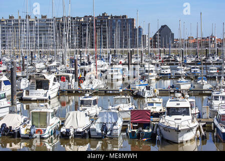Sailing boats, motorboats and pleasure yachts in the marina at seaside resort Blankenberge along the North Sea coast, West Flanders, Belgium - Stock Photo