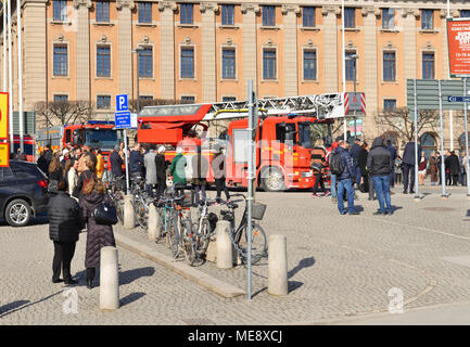 Fire trucks, police and rescue vehicles on Gustav Adolfs torg (square). People evacuated from Ministry of Foreign  Affairs - Stock Photo