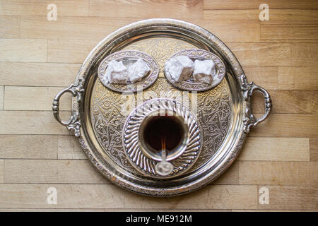 Turkish delight lokum in silver tray served with tea of coffee - Stock Photo